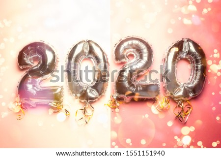 Balloon Bunting for celebration of New Year 2020 made from Silver Number Balloons. Holiday Party Decoration or postcard concept with top view and copy space. #1551151940
