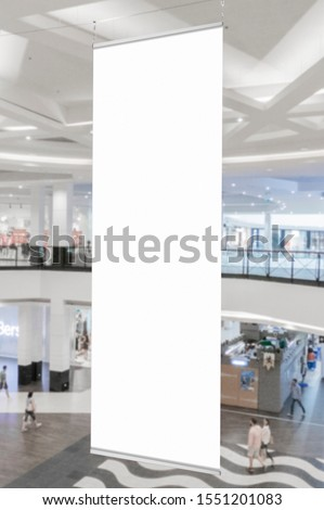 Mockup of blank white vertical indoor advertising flag hanging in shopping centre or mall