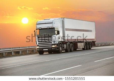 truck goes on highway in evening on sunset #1551201551