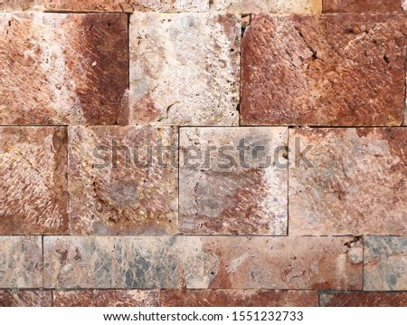 Pattern of decorative red stone wall background.Stone wall texture. random size stone wall.Background of stone wall. #1551232733