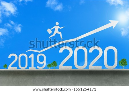 Businessman jumping from 2019 to 2020 #1551254171