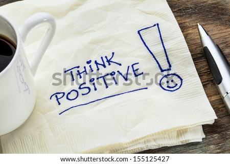 think positive - motivational slogan on a napkin with a cup of coffee Royalty-Free Stock Photo #155125427