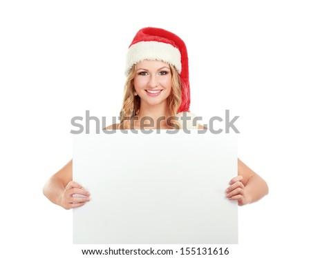 Beautiful christmas woman in santa hat near empty board #155131616