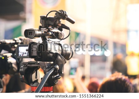 Professional video camera with abstract blurred background #1551366224