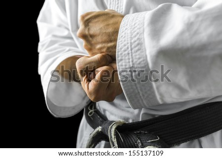 Closeup of male karate fighter hands. Royalty-Free Stock Photo #155137109