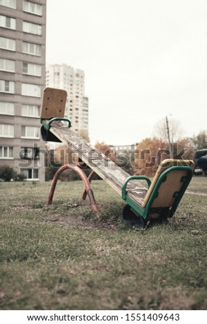 Empty children's swing, no people, no children - gray, sad picture #1551409643