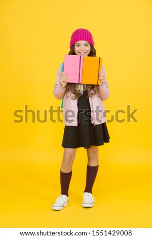 Innovating existing platforms. Future textbooks modern education. Textbook useful in learning environment. School creating textbooks generation. Active role in curriculum. Schoolgirl with textbooks. #1551429008
