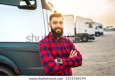 Young bearded man standing in front of his truck. #1551540194