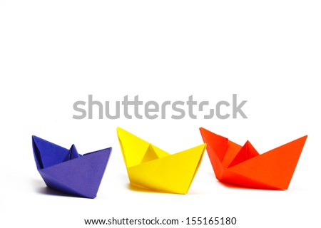 Three colored paper ship on a white background #155165180