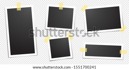 Polaroid photo frames fixed with adhesive tape on a transparent background. Photo frame on sticky tape, isolated.  #1551700241
