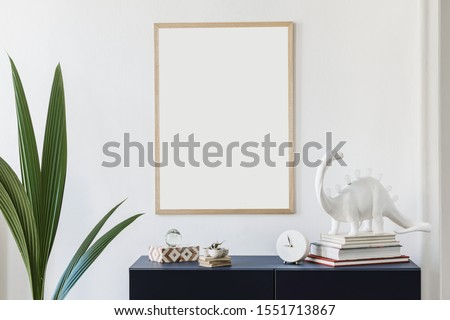 Stylish scandinavian living room with mock up poster frame,  navy blue commode, table lamp and elegant accessories. Modern home decor. Interior design. Template Ready to use.