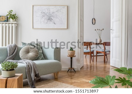 Stylish scandinavian living room and dining room with design mint sofa, mock up poster map, plants and elegant personal accessories. Modern home decor. Open space. Template. Ready to use.  #1551713897
