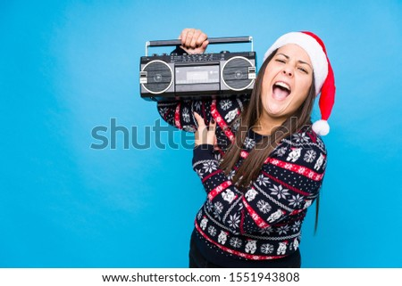 Young woman celebrating christmas day #1551943808