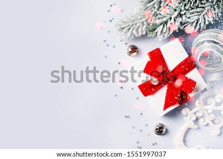 Christmas gift box flat lay on white background with decoration. Happy new year background and backdrop, copy space, top view #1551997037