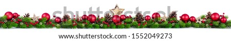 Extra wide Christmas border with fir branches, red and silver baubles, pine cones and other ornaments, isolated on white #1552049273