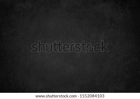 Black grunge wallpaper. Abstract background. Chalkboard texture. Wall texture. Grung. Concrete