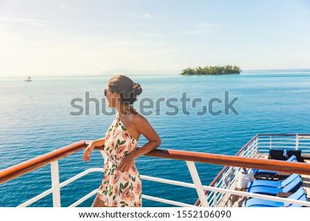 Cruise ship travel vacation woman looking at ocean from deck of sailing boat. Luxury Tahiti Bora Bora French Polynesia destination summer lifestyle. #1552106090