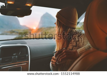 Woman on road trip traveling by rental car relaxing with coffee cup adventure lifestyle vacations vibes outdoor sunset Norway mountains view in window  #1552114988
