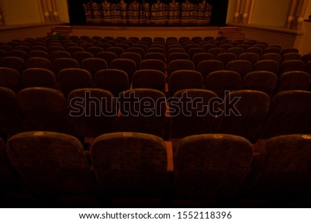green velvet seats for spectators in the theater or cinema #1552118396