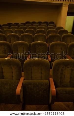 green velvet seats for spectators in the theater or cinema #1552118405
