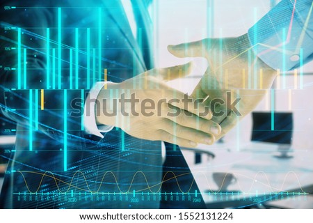 Multi exposure of financial graph on office background with two businessmen handshake. Concept of success in business #1552131224