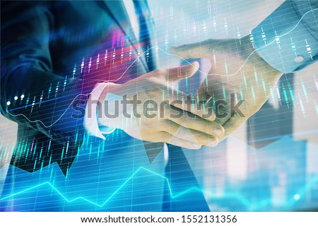 Double exposure of financial graph on cityscape background with two businessman handshake. Concept of stock market deal #1552131356