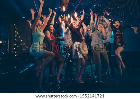 Full length body size photo of company dancing cheerfully at night club under falling confetti and light of shining lamps with smiles on their faces #1552141721