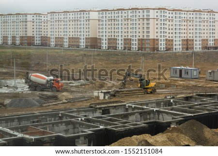 Construction site with venicle transport on a building complex #1552151084