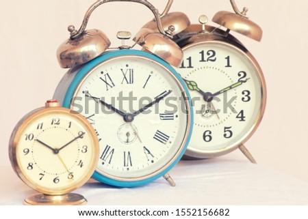 Three vintage alarm clocks of different sizes #1552156682