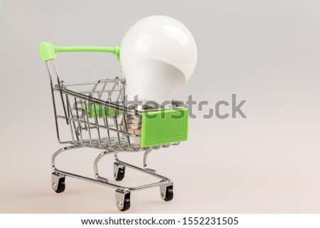 supermarket shopping cart with modern led light bulb isolated close-up, macro, shopping concept of modern eco-friendly economical lighting equipment #1552231505