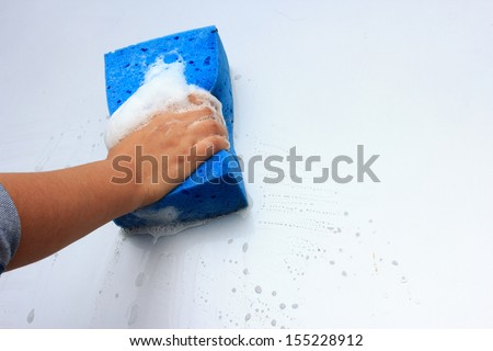 cleaning car wash with a sponge #155228912