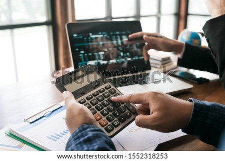 Two young business man working using touchpad at meeting with computer in team.  #1552318253