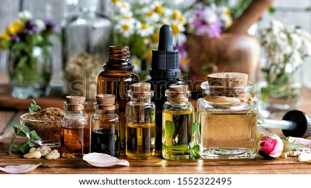 Aromatherapy essential oil images on the table  #1552322495