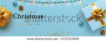 Christmas banner. Background Xmas design of sparkling lights garland, realistic gifts box, blue balls and glitter gold confetti. Horizontal christmas poster, greeting cards, headers website #1552356800