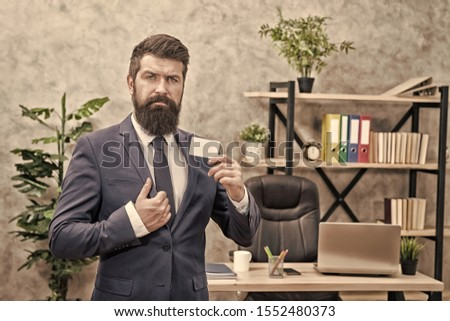 Banking services for small business. Card design. Call now. Guy formal suit stand in office. Accountant or banker. Businessman hold blank card. Useful contacts. Bearded hipster top manager show card. #1552480373