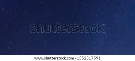 Panorama blue night sky milky way and star on dark background.Universe filled with stars, nebula and galaxy with noise and grain.Photo by long exposure and select white balance.selection focus.amazing #1552517591