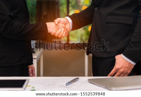 Businessman and businesswomen shaking hands after dealing and partnership. Bussiness partnership concept. #1552539848