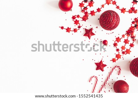 Christmas composition. Red decorations on white background. Christmas, winter, new year concept. Flat lay, top view, copy space #1552541435