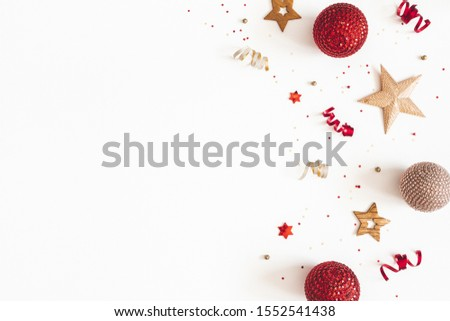 Christmas composition. Red and golden decorations on white background. Christmas, winter, new year concept. Flat lay, top view, copy space #1552541438