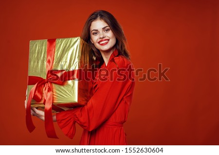 Gift box with red bow and happy woman makeup fashion holidays #1552630604