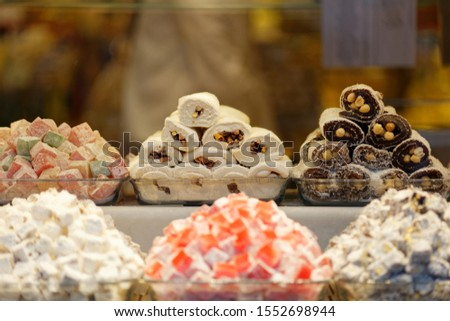 Turkish Delight in white rolled, black rolled, colorful cube forms with almond, walnut, and pistachio. Also known as Palace Wrap, Sultan Wrap or Sultan Delight. #1552698944