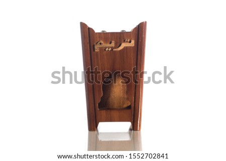 """Isolated picture. Unique wooden shape design of """"bakhoor"""" burner. """"Bakhoor"""" is name given to agarwood chips that have been soaked with jasmine and sandalwood to soften and sweeten the heavy scents. #1552702841"""