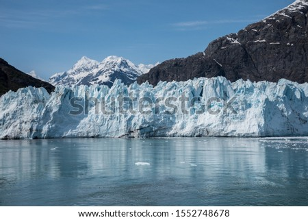 Glacier Bay Alaska Glacier and Mountains Beautiful Scenic View , Glacier melting and falling into the ocean  #1552748678