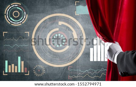 Hand opening red curtain and drawing business graphs and diagrams behind it #1552794971