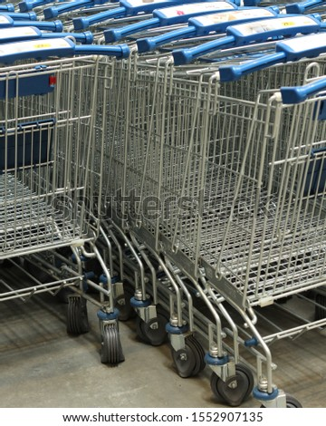 Shopping cart in a row in storage area #1552907135