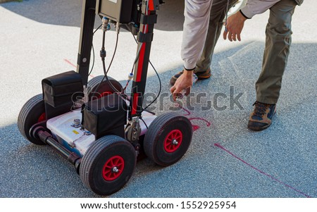The GPR is a noninvasive method used in geophysics. It is based on the analysis of electromagnetic waves transmitted into the ground reflections. Royalty-Free Stock Photo #1552925954