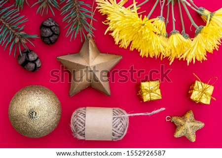 Creative Composition Useful for Christmas and New Year Greeting Card Created Using Decorative Ball, Decorative Stars, Yellow Gift Boxes, Pine Cones, Yellow Flowers, Packthread and Green Pine Branch #1552926587