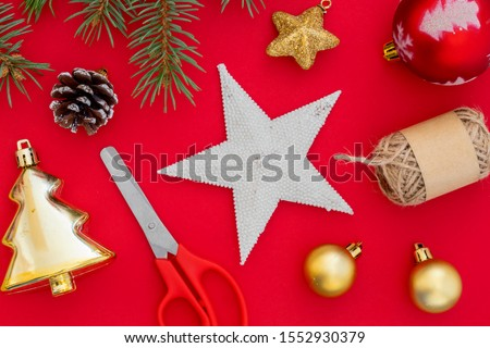 Creative Composition Useful for Christmas and New Year Greeting Card Created Using Decorative Balls, Decorative Stars, Pine Cone, Scissors, Packthread and Green Pine Branch #1552930379