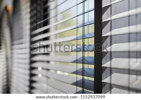 Office blinds. Modern wooden jalousie. Office meeting room lighting range control. Royalty-Free Stock Photo #1552937099