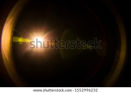 Abstract Natural Sun flare on the black Royalty-Free Stock Photo #1552996232